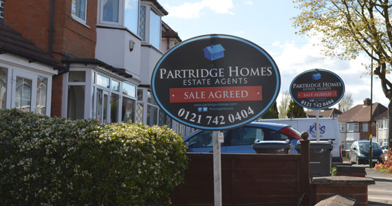 Photo showing multiple Partridge Homes Sale Agreed boards in a residential street.